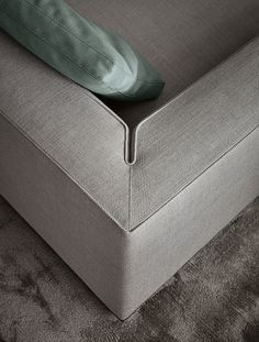 clever sofa corner detail, piped or stitched line, tailored finish.
