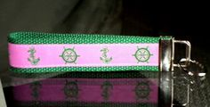 This listing is for a 6 inch long key fob made of high quality woven jacquard ribbon and heavy-duty cotton webbing.  It has a nickel fob tip and split ring.  The ribbon is pink with nautical anchors a