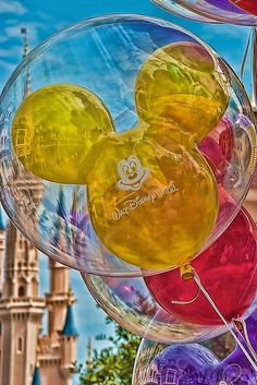 Mickey Balloons in the Magic Kingdom at Walt Disney World, FL. Love this picture. Did you know IF you lose your balloon (or it deflates or pops) and have kept the receipt, you can get a free replacement from any balloon seller? Disney cooool.