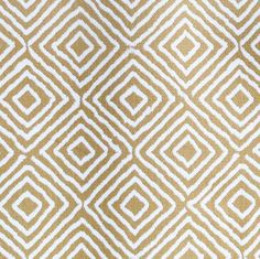 An upholstery diamond patterned fabric in warm cognac and cream. This fabric is very durable and is perfect for heavy weight upholstery.