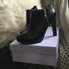 ❤️Price Reduced❤️Marc Fisher Booties Worn twice. Size 8. Marc Fisher booties with gold hardware trim. Gold zippers are ornamental. Plain black zippers to get into bootie. Anaconda like front. Marc Fisher Shoes Ankle Boots & Booties