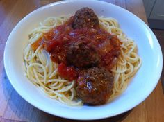 Meatballs in rich tomato sauce.
