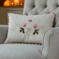 the linen love birds cushion is a wonderful thoughtful present, especially with the quirky pom pom trim
