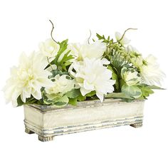 """Our arrangement brings more spring spirit to a 20"""" x 12"""" footprint than we ever thought possible. A variation on the timeless theme of window box planters, this ensemble will flourish in any spot and bring the expansiveness of the season with it."""