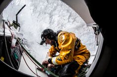 March 19, 2015. Leg 5 to Itajai onboard Abu Dhabi Ocean Racing. Day 01.  After grabbing several cups of coffee for the guys on deck, Justin Slattery crouches under the protection of the coachroof as another wave comes roaring overhead - Matt Knighton / Abu Dhabi Ocean Racing / Volvo Ocean Race
