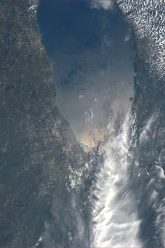 Chicago and Milwaukee on Lake Michigan.  KN from space.