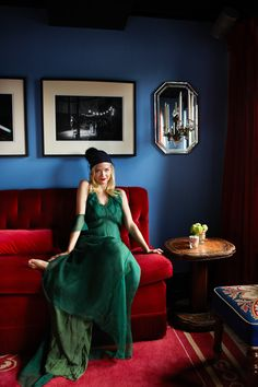 Eclectic - Jaime King seated on a tufted red banquette