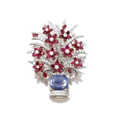 GEM SET AND DIAMOND BROOCH, BULGARI, CIRCA 1965 Of bouquet design, set with a cabochon sapphire, pear-shaped rubies, brilliant-cut and baguette diamonds, signed Bulgari