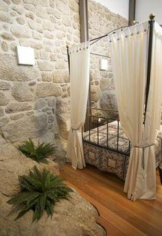 I love how this room is built around the stone, incorporating it into the design. Beautiful. -- Solar Dom Silvestre, Castelo Novo, Fundão, Castelo Branco, Portugal