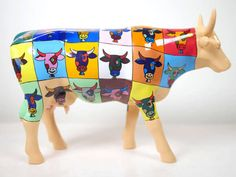 "This ""POP ART"" cow of the Museum Edition collection is a miniature replica of the original cow created for the Boston CowParade event in 2006. It is inspired by the artwork of Andy Warhol."