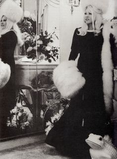 """Legendary MAE WEST at 77 in her apartment at The Ravenswood  """"reflected in her mirrors in a bowel of Forest Lawn plastic flowers' photo & comment by bitchy CECIL BEATON, who was no spring chicken at the time either. Mae had just filmed the camp classic MYRA BRECKINRIDGE (minkshmink)"""