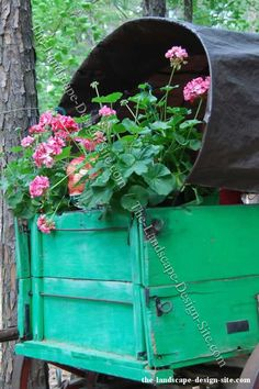 decorating gardens with antiques | Antique Covered Wagon Planter Full Of Flowers
