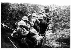 Men of the 13th Battalion, Durham Light Infantry (23rd Division), rest in a communication trench before the attack on Veldhoek, one of the battles of Third Ypres (Passchendaele), September 1917. In addition to their personal arms...