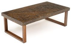 Hand-hammered, this chic metal coffee table is sure to add rich texture, warmth and a rustic, yet modern appeal to any room in your home. Available with a wood or stainless steel base (brushed or polished finish), this custom-made design works equally well with traditional and modern décor. We would be delighted to create a