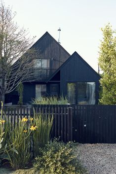 One of the first decisions they made was to paint the house's exterior black. (Maria McManus' and Mark Gibson's weekend place, a double A-frame built in 1982 in the Ditch Plains area of Montauk)