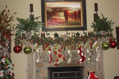 personalized stockings, large ornaments, garland, and evergreen clippings for the fireplace