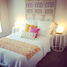 White/Neutral bed linens with colorful pillows - Emily's Room