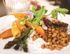 A local plate of fresh pea tendrils, rainbow carrots, Keegan-Filion pork, Carolina Gold Rice, and Sea Island Red Peas