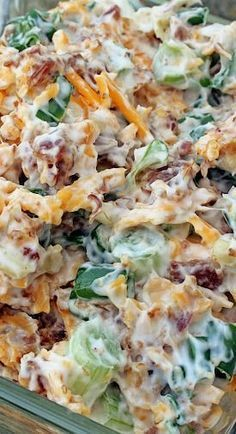 Neiman Marcus Dip ~ 5 - 6 green onions, 8 oz. cheddar cheese, shredded, 1 1/2 cups mayonnaise, 1 jar Hormel Real Bacon Bits, 1 pkg. slivered almonds. Chop the green onions. Shred the cheddar cheese. Mix the onions, cheese, mayo, bacon bits, and slivered almonds together. Chill for a couple hours. Serve with Ritz crackers or corn chips.