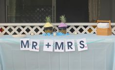 Honeymoon (Bora Bora) themed Bridal shower!! Cute boy and girl pineapple people for the food table!