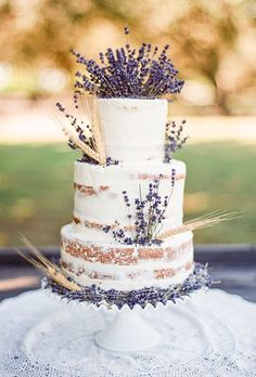 Brides.com: . A semi-naked, three-tiered wedding cake topped with fresh lavender and wheat, created by Johnson's Custom Cakes and More.