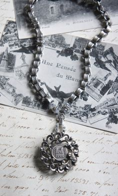 Notre Dame-Vintage assemblage necklace with book chain and vintage Notre Dame pendant by frenchfeatherdesigns on etsy