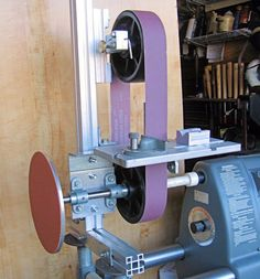Belt Grinder by peterm -- Homemade lathe-powered belt grinder featuring an integral chisel sharpener. Fabricated from extruded aluminum, steel, casters, bearings, and hardware. http://www.homemadetools.net/homemade-belt-grinder-59