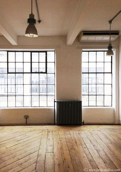 Wood floors, industrial windows, pendants, natural, wood, black, white // studio space