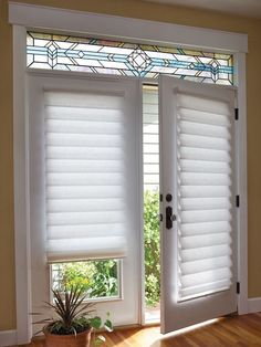 White Vignette Modern Roman Shades on a French Door, for sale at Classic Blinds & Shutters Design Center in Alpharetta #windowcoverings