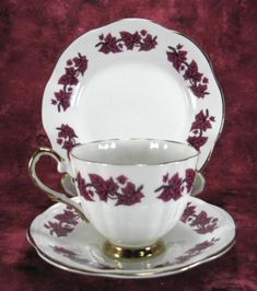 This is a pretty purple ivy leaf or grape leaf patterned English bone china cup and saucer with matching plate or teacup trio made in the 1950s by Clare China,