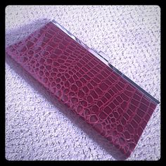 "Apostrophe Burgundy Clutch or Chain Purse- NWOT Never used, in perfect condition. Patent croc pattern burgundy clutch. Can pull out or store silver chain strap. Drop is approximately 12"". Length is 10"", and height is 5"". Inside lined with matching colored canvas. Card pocket on one side, zipper coin pocket on the other side. Lots of room for a fun little clutch! Apostrophe Bags Clutches & Wristlets"