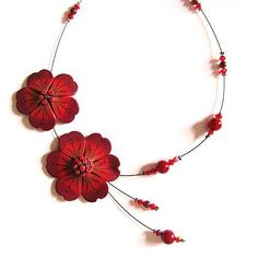 Beautiful floral necklace! I'd make a Fimo one with bats/moons
