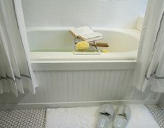 The Everyday Home: create beadboard look on the bathtub using 4x8 sheets of bead board from Lowe's, and some mouldings.
