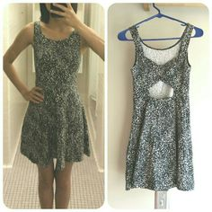AE * Speckled Dot Print Cross Back Dress Sleeveless black dress with gray/white speckled dot print. Cross detail with opening at the back, and elastic waist. Fitted at the bodice with flared skirt. Soft and light stretchy cotton fabric. Worn only once. American Eagle Outfitters Dresses