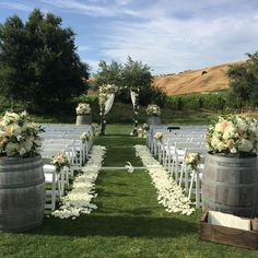 I like the idea of tying off the aisle and you could have ribbons on the chairs without flowers on them...