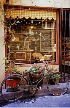 I pinned this...then went to Lexington, NC, with my husband, and saw a book shop owner ride up to his store on an old bike which he set in front of the window!  09.13.13
