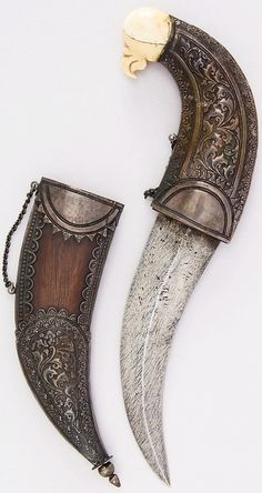 Indian jambiya, 19th century, steel, silver, wood, ivory, H. with sheath 10 3/4 in. (27.3 cm); H. without sheath 10 1/8 in. (25.7 cm); H. of blade 6 1/4 in. (15.9 cm); W. 4 1/4 in. (10.8 cm); Wt. 7.7 oz. (218.3 g); Wt. of sheath 2.4 oz. (68 g), Met Museum, Bequest of George C. Stone, 1935.