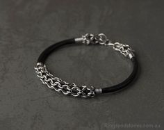 Viking inspired stainless steel chainmaille leather bracelet.