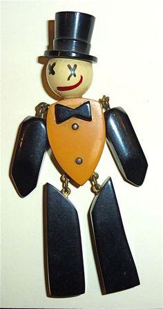Bakelite tuxedoed stick figure