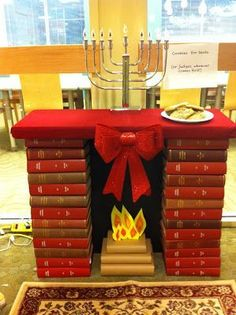 Book fireplace display for the holidays. The Sassy Librarian: Celebrating the Holidays, Library Style! School Library Displays, Middle School Libraries, Library Inspiration, Library Ideas, Library Lessons, Library Programs, Library Design, Library Books, Book Crafts