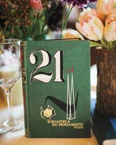 """See the """"Novel Numbers"""" in our A Botanical and Whimsical DIY Manhattan Soiree gallery. To make the table numbers, Eric cut digits from the pages of vintage books and pasted them to the covers. Book Table Numbers, Vintage Table Numbers, Unique Table Numbers, Wedding Table Numbers, Table Wedding, Wedding Dinner, Wedding Guest Book, Diy Wedding, Wedding Groom"""