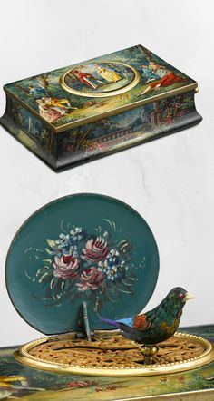 French Singing Bird Box by Flajoulot ~  his early 20th-century singing bird box is the work of E. Flajoulot of  Paris. This unique wooden box is enveloped in the most exquisite  enameling. When activated, a stunning hand-feathered bird sings a  delightful tune. Flajoulot's bird boxes are known for having the finest  non-fusée movements of the era                           19th Century Antiques, Aristocracy ~ M.S. Rau Antiques