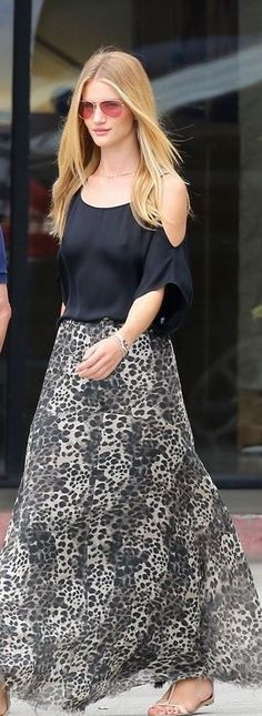 Rosie Huntington-Whiteley: Sunglasses and skirt – Etoile Isabel Marant  Shoes – Giuseppe Zanotti  Jewelry – Anita Ko