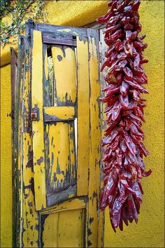 "Yellow wooden window shutters with dried red peppers hanging on Southwest yellow adobe wall in the old Barrio historic section of Tucson, AZ. Image title: Peppered Light This image is from my photography architectural series of Southwest windows and doors from the past. All photographs are original and photographed by artist Bob Estrin. Photographs are available in a variety of sizes as a print or as a gallery wrapped canvas. Photograph sizes available: Using the ""Select Options"" drop…"