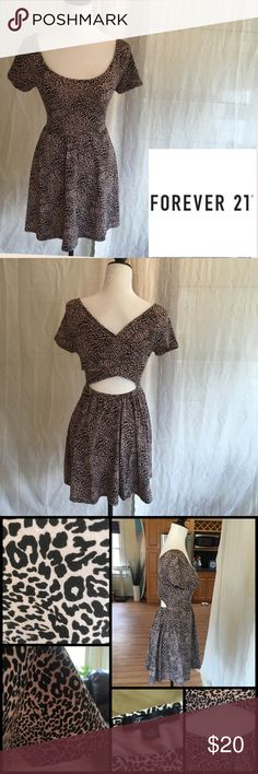 NWOT Forever 21 Leopard Cutout Gathered Dress This charming leopard print pattern has a low scooped neckline and gathered waist with cap sleeves. The back has a criss cross style with a peep hole just above the waist. The back waist is elasticized for leeway and comfort. Great everyday hangout dress. A dress with a little pizazz. NWOT. 94% polyester 6% spandex. Excellent condition. Sz S/P Forever 21 Dresses Asymmetrical