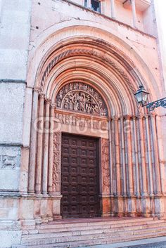 A portal of the Baptistery of Parma, built with pink marble