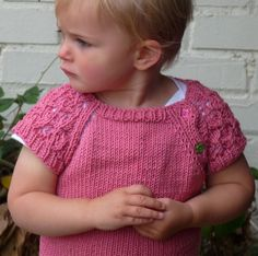 """Free Knitting Pattern for Lace Sleeved Baby Pullover -This baby sweater """"HINE is a Girl"""" by Kelly van Niekerk features beautiful lace leaf short sleeves and buttons at the yoke for easy dressing. Great for layering or by itself in warm weather. Size 18-24 months. Pictured project by hetty24tigger"""