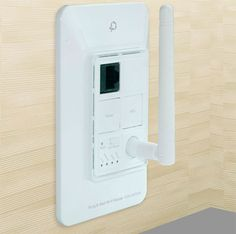 Planex Wi-Fi router first in wall power socket