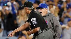 Cubs' Maddon tossed for arguing replay reversal