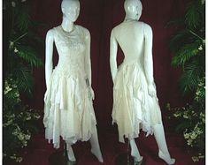 Cream satin shabby wedding dress, #bohemian #boho #whimsical #wedding #love #prom #weddingdresses #promdresses #eventdresses #renaissiance #steampunk #gothic #pagan #medieval #hippy #romance #bridetobe #gettingmarried #unique #handmade #oneofakind #tattered #shabbychic #dress #dresses #tuxedos #bowties #themedwedding #alternative #alternativewedding #differentdress #specialevent #motherofthebride #bridesmaids #flowergirl #weddingday #dreamwedding #inlove #countrywedding #frenchcountry #fashion # Woodland Wedding Dress, Vintage Inspired Wedding Dresses, Wedding Dresses For Girls, Bohemian Wedding Dresses, Wedding Dress Sizes, Whimsical Wedding, Bridesmaid Dresses, Different Dresses, Unique Dresses